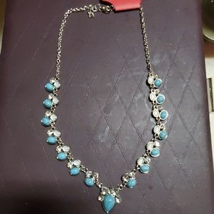 Turquoise and silver plated necklace.
